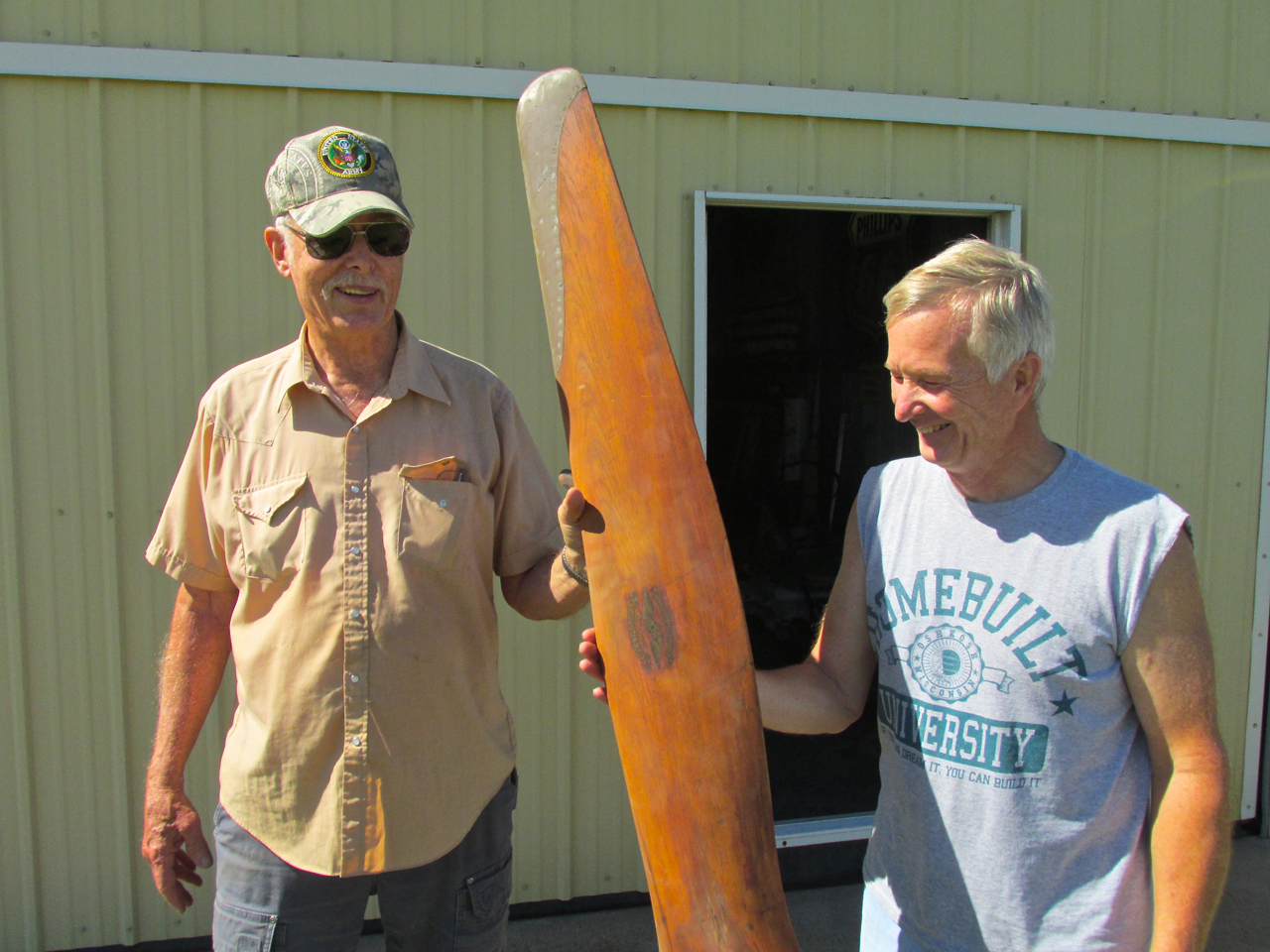 Robert Yarmer hands Ken Lebbin a famous propeller. The person Robert got it  from told him it came off a Curtis Jenny! No doubt from back in the  barnstorming ...